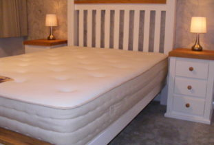 double white and oak bed