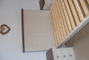 Wooden bed and bedside cabinets