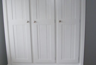 White wooden wardrobe with storage