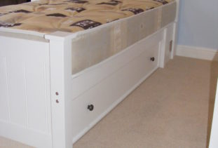 white wooden bed with storage