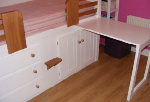 White wooden cabin beds