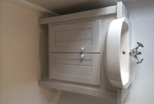white wooden vanity unit