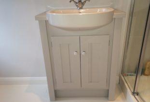 white wooden vanity units