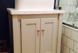 grey double vanity unit with marble top