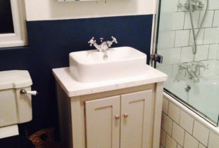 grey vanity unit with marble top