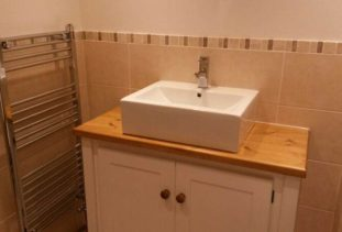 white wooden vanity unit with oak top