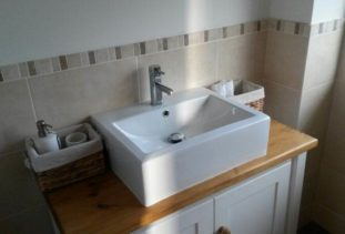 white wooden vanity unit with oak veneer top