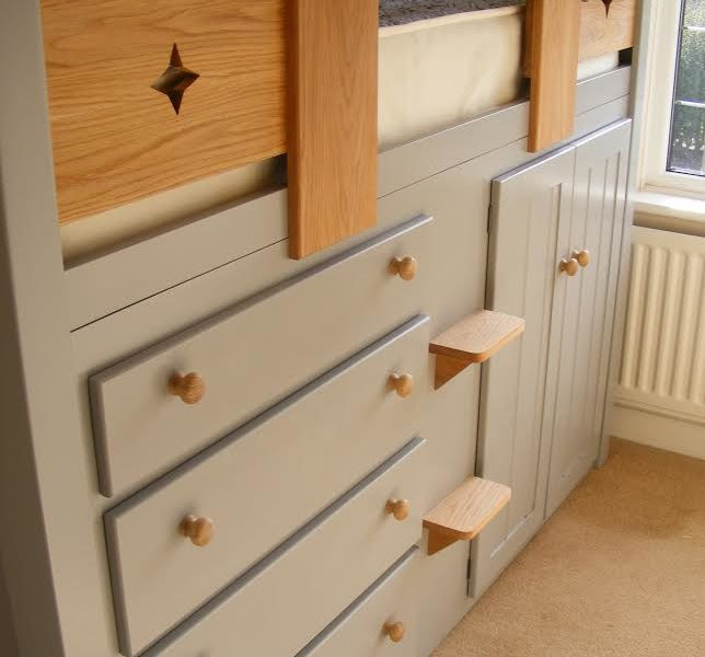 grey wooden cabin beds