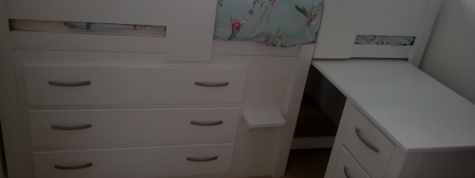 White wooden cabin bed with pull out desk