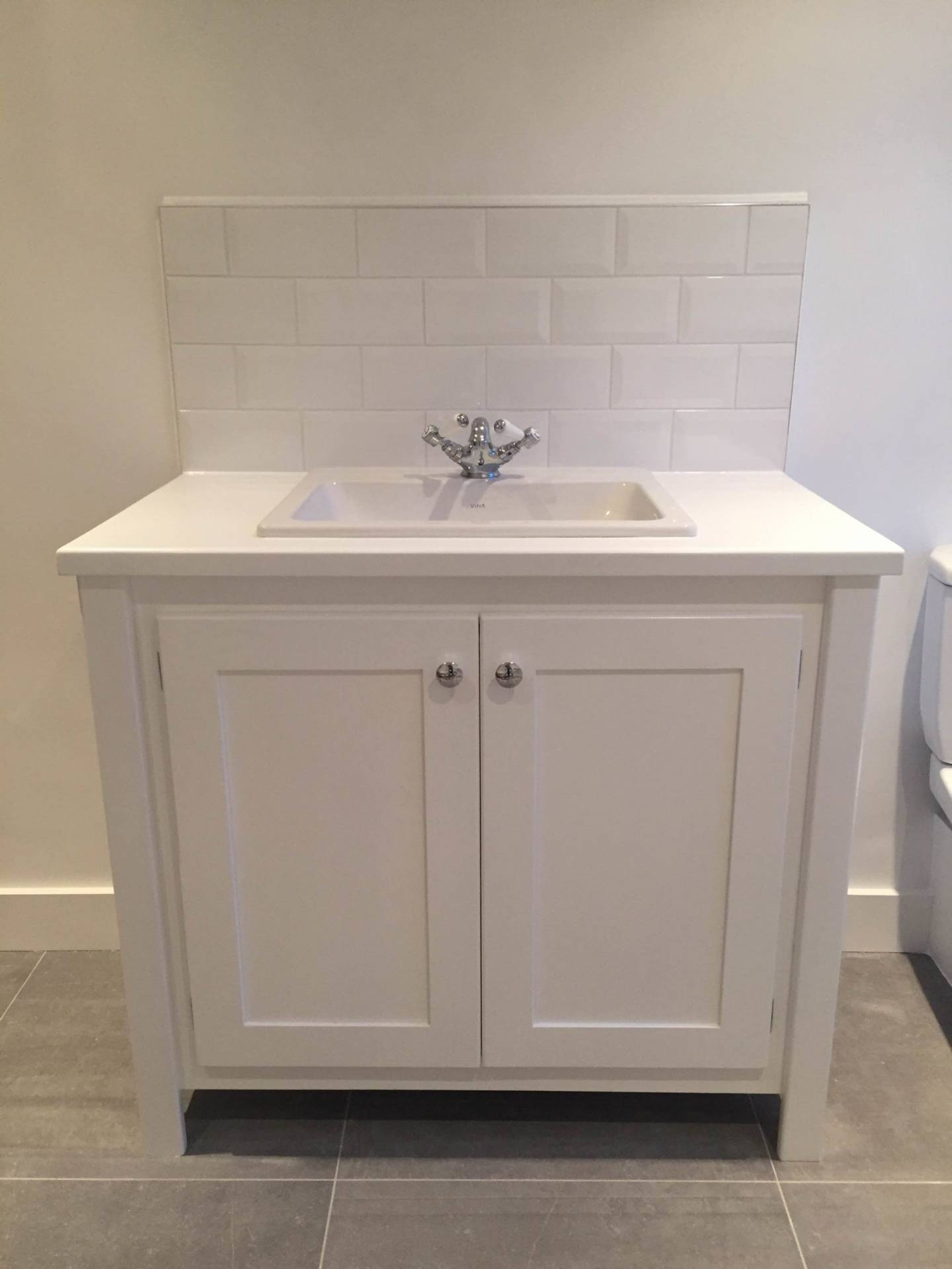 White vanity unit with painted top