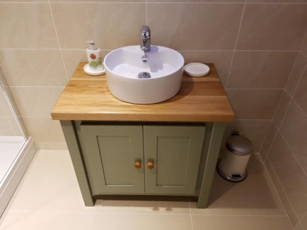 Card room green vanity unit with solid oak top
