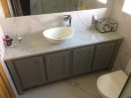 Double Vanity Unit With Single Basin In Pavillion Grey With A Carrara Marble Counter Top