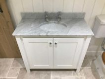 White Vanity Unit With Single Undercounter Sink. Carrara Top & Splashback