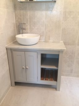 Bespoke vanity unit in pavillion grey , carrara top and solid oak slats