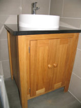 Solid Oak Vanity Unit With A Black Granite Top