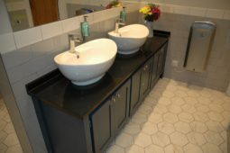 Double Countertop Sinks on Black Granite with Splashbacks